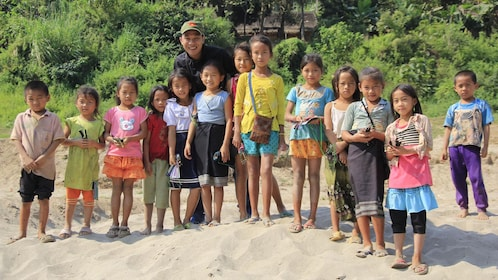 Children on a river bank in Laos