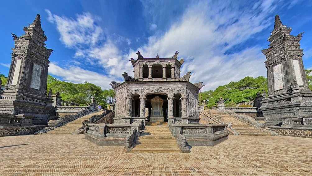 Show item 5 of 6. walking through a historic temple in Vietnam