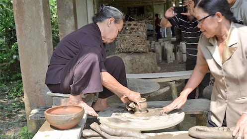 women making pottery in Vietnam