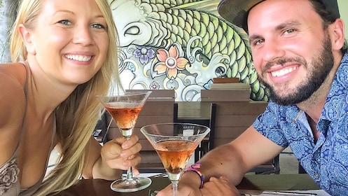 A couple drinking martinis