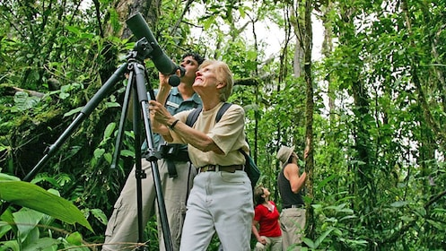 woman looking through a scope in Costa Rica