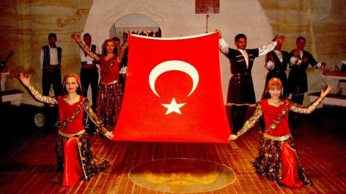 Dancers hold up Turkish Flag