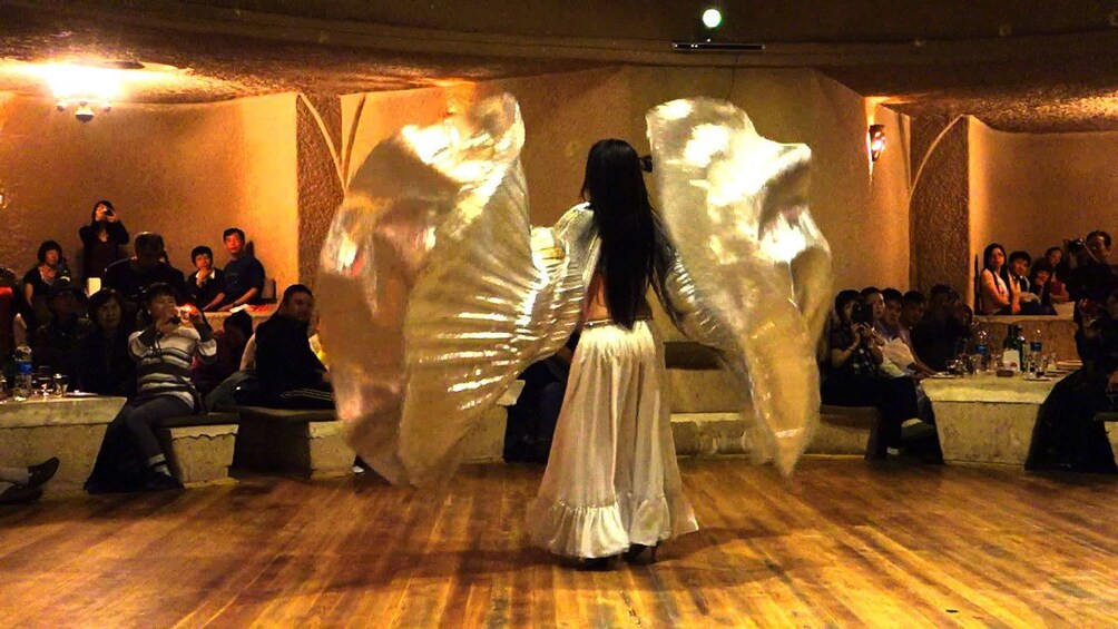 Show item 3 of 5. Belly Dancer in restaurant