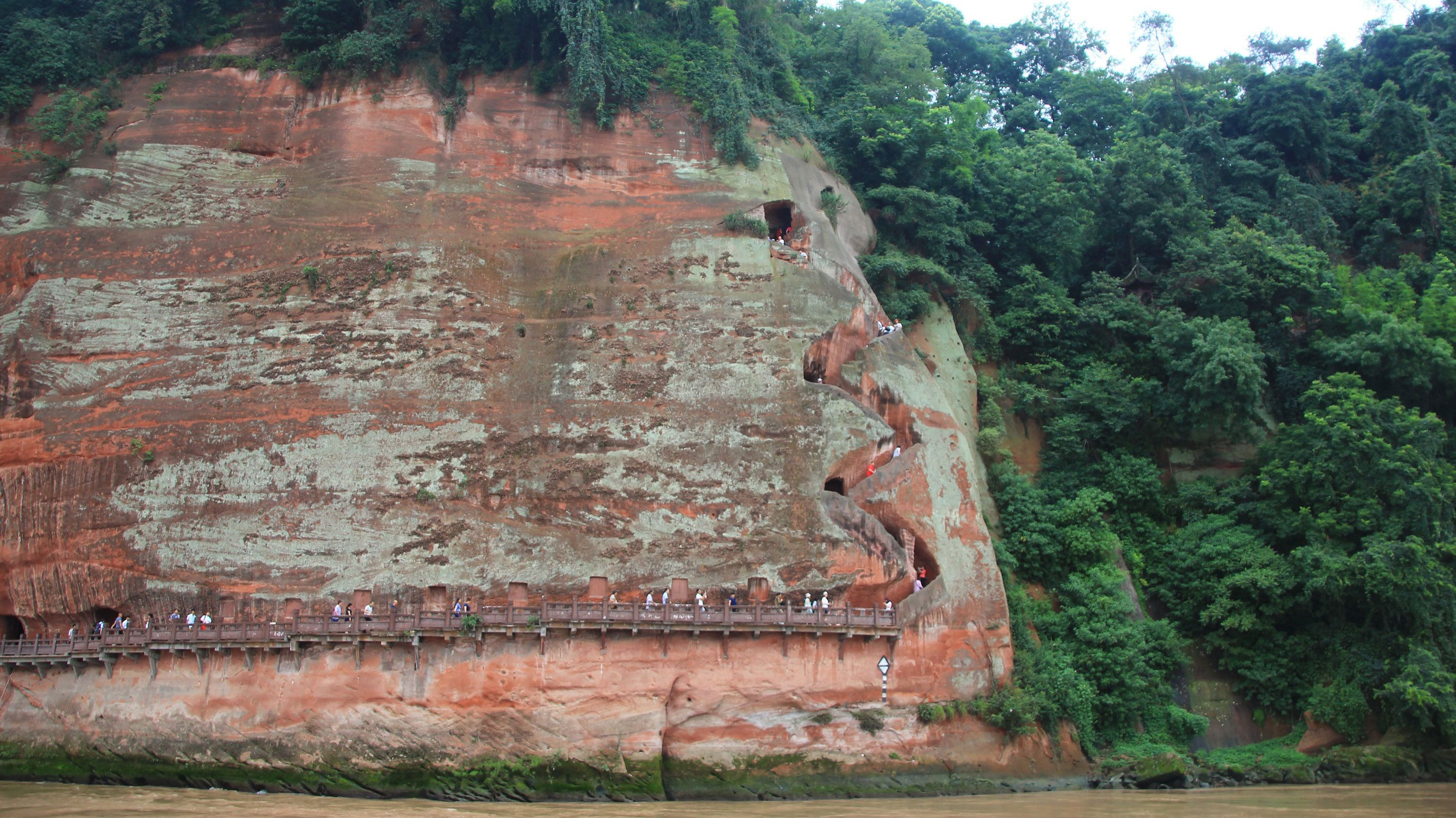 Cliffside stairs to a Buddha statue