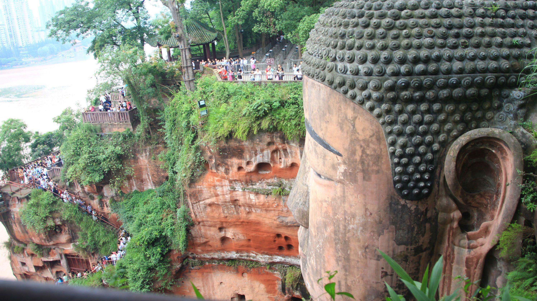 Tourists visit a large Buddha statue