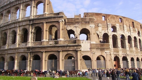 People outside of the coliseum in Rome