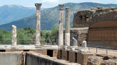 Pillars with mountains in the distance in Tivoli