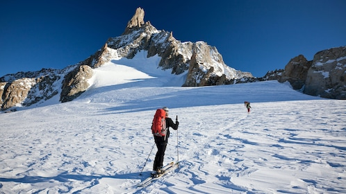 Skiers making way up mountain in Chamonix