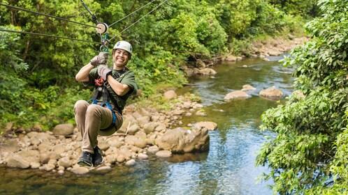 woman zip lining across a creek in Costa Rica
