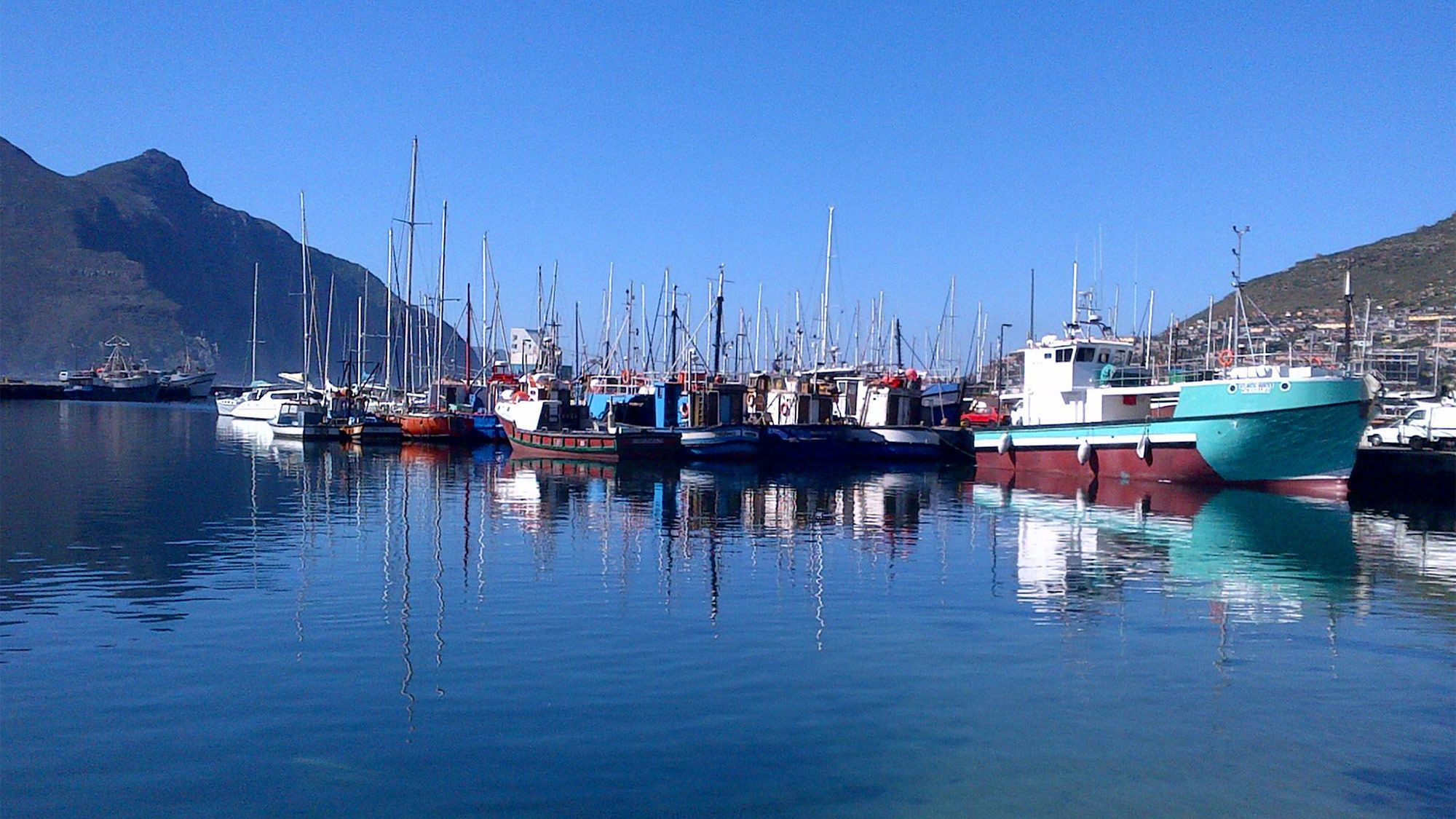 Reflective view of Cape Peninsula with sailboats in South Africa