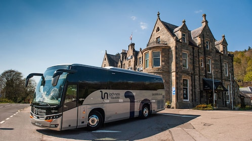 Tour bus at a large historic home in Inverness