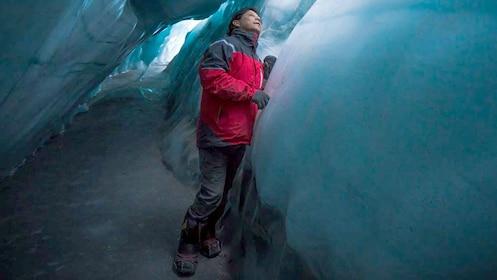 Man walking in a crack of a glacier