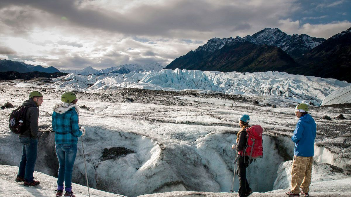 Climbers next to glacier in Alaskan wilderness