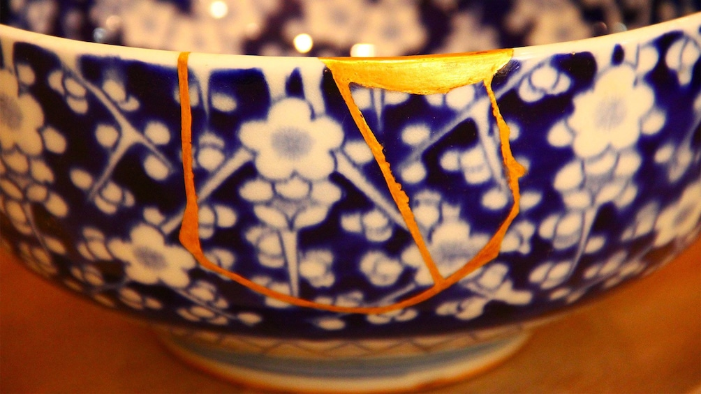 Show item 2 of 10. View of a bowl that was repaired at the Kintsugi Pottery Repairing Experience in Tokyo