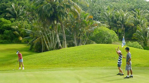 Golfers on a golf course in Guam