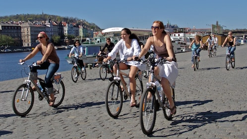 people riding bicycles through city streets