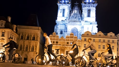bicycles in front of illuminated building at night