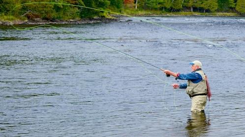 Man fly fishing in Fairbanks