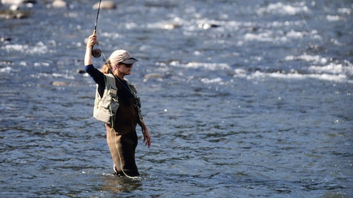 Fly fishing woman in a river in Fairbanks