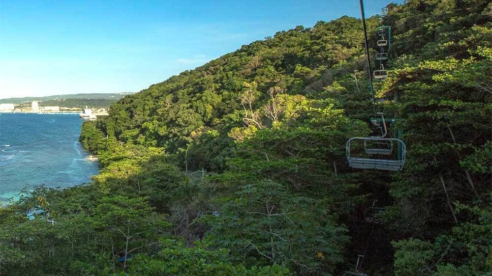Chairlift through the trees near the coast in Ocho Rios