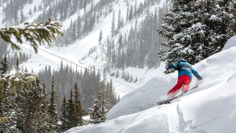 Snowboarding going down a hill in Colorado
