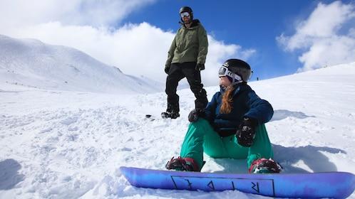 Snowboarding couple on a mountain