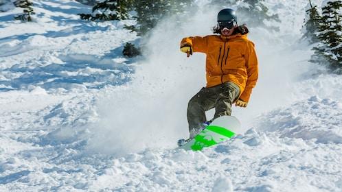Snowboarding man on a mountain