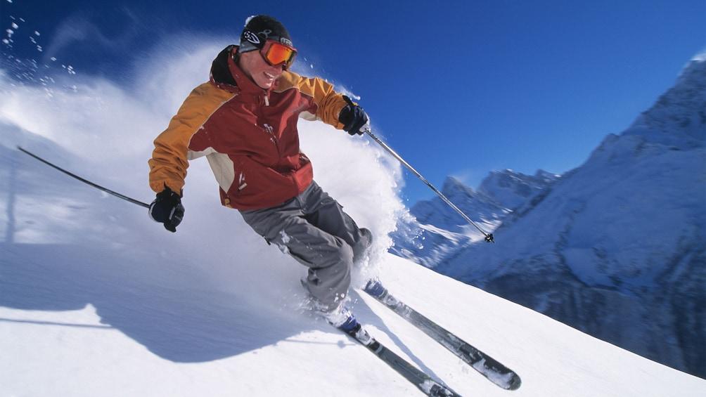 Cargar ítem 1 de 5. Skiing man on the slopes