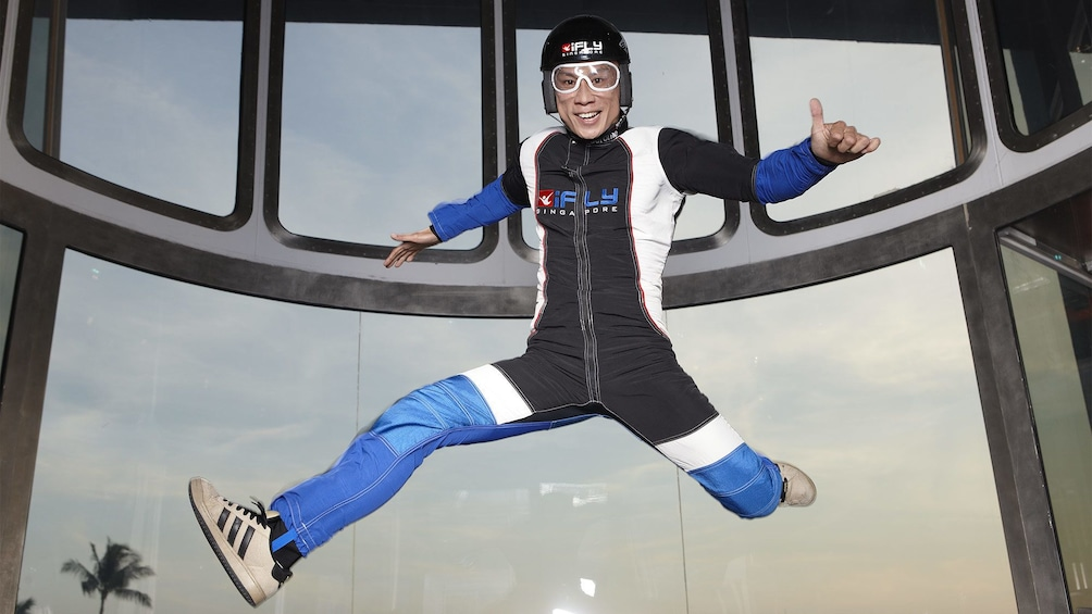 Show item 1 of 5. Man having a good time at iFly Singapore