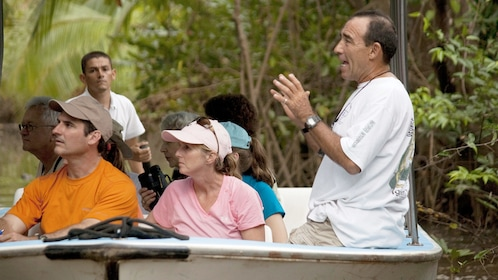 Tour group sitting on a boat on the Damas Island Mangrove tour in Costa Rica