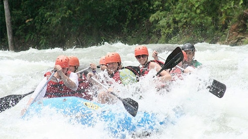 Group getting splashed on the Whitewater Rafting in the Savegre River
