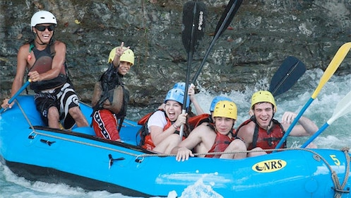 Group having fun on the Whitewater Rafting adventure in Savegre River