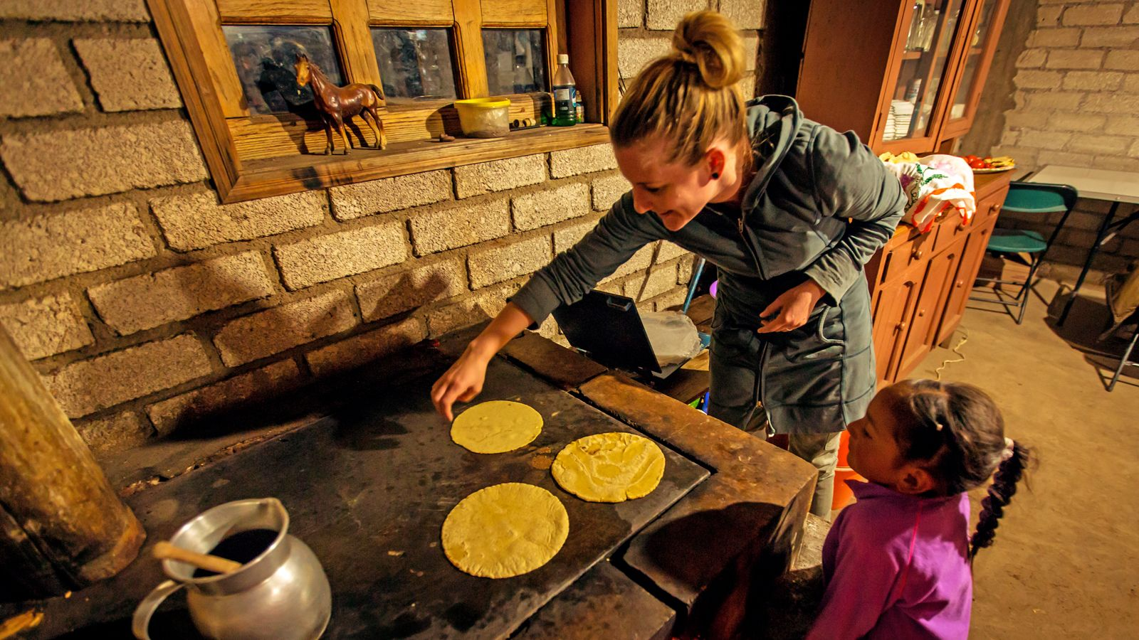 making tortillas inside a home in Mexico