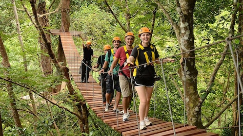 Group crossing a bridge on the Flying Hanuman Course in Phuket