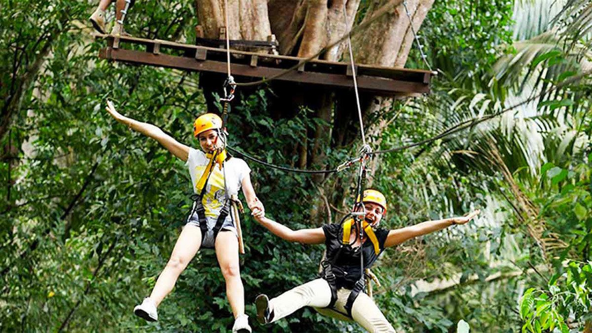 Two ladies having fun on the Flying Hanuman Course in Phuket