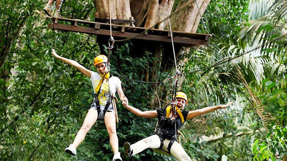 Show item 2 of 5. Two ladies having fun on the Flying Hanuman Course in Phuket