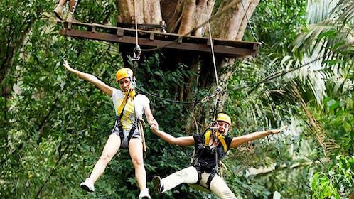Two ladies having fun on the Flying Hanuman Course in Phuket