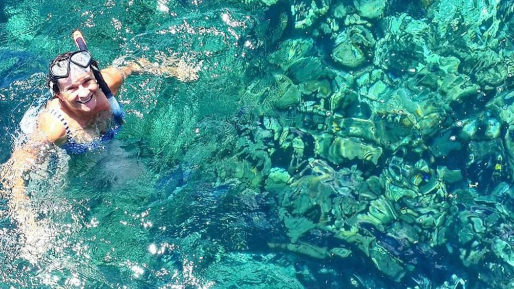 woman snorkeling in Trinidad and Tobago
