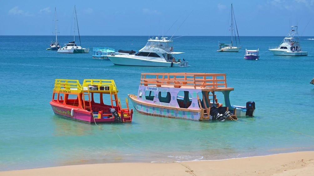 Show item 5 of 5. empty boats anchored near the beach in Trinidad and Tobago