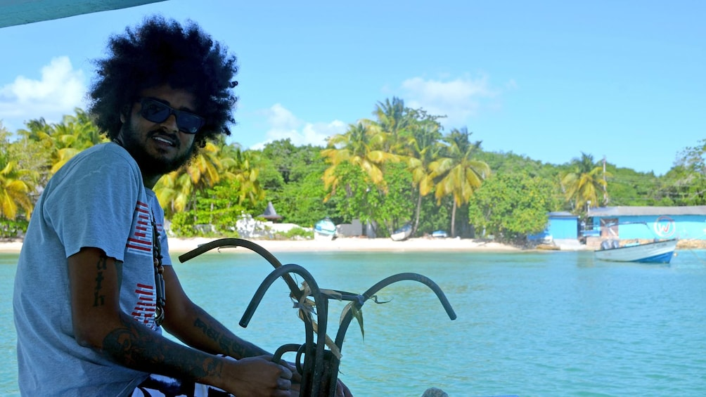 Show item 2 of 5. man on a small boat in Trinidad and Tobago