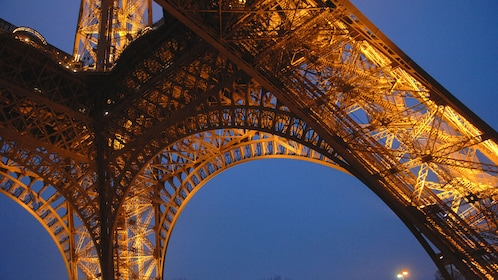 Night base view of the Eiffel Tower in Paris