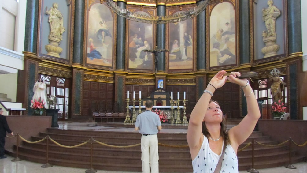 Show item 1 of 5. Woman taking pictures in El Salvador church