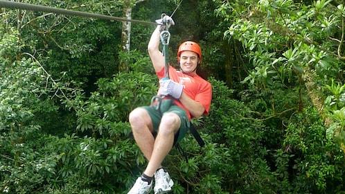 Man ziplining in Costa Rica