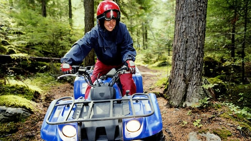 Woman on an ATV in the forest in Costa Rica