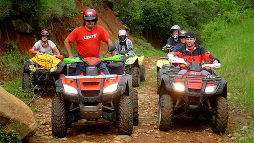 ATV riding group on a dirt path in Costa Rica