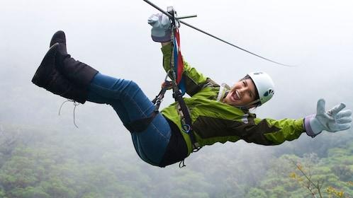 Smiling woman ziplining in Costa Rica