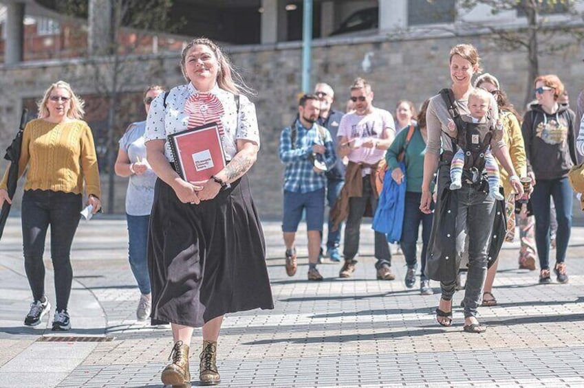 Tour guide and comedian Suzy Bennett leading a group down Cornwall Street.