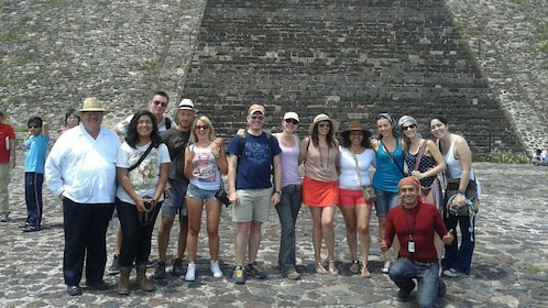 Tour group at the base of a Mexican Pyramid