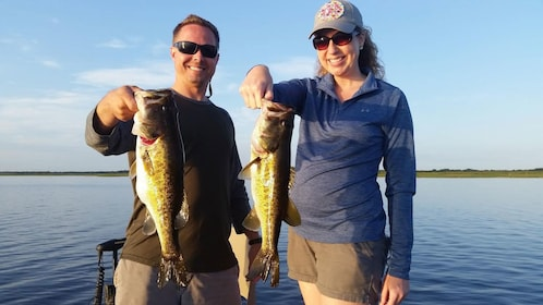 Couple with caught bass in Naples