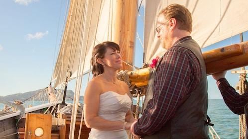 Wedding couple saying vows on Bay of Island Cruise.